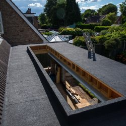 Flat Roof with skylight by ADN Roofing